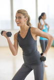 Happy Woman Lifting Dumbbell At Gym Royalty Free Stock Photos