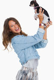 Happy woman lifting her chihuahua Royalty Free Stock Images