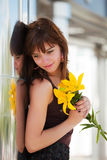 Happy fashion woman with a flowers daydreaming Stock Image