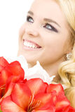 Happy woman with lily flowers royalty free stock photography