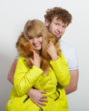 Happy woman in lime jacket and man. Fall fashion. Stock Photo