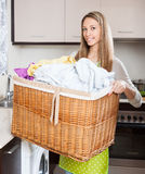 Happy woman with linen basket Royalty Free Stock Photos