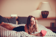 Happy woman in lingerie bed. Valentines day love Stock Images