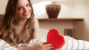 Happy woman in lingerie bed. Valentines day love Royalty Free Stock Image