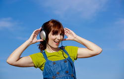 Happy woman listen music Stock Photo