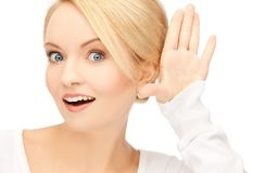 Happy woman listening gossip Royalty Free Stock Image