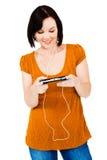 Happy woman listening media player. Happy woman listening to music on an media player isolated over white Stock Photos
