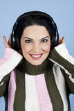 Happy woman listening music Stock Images