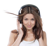 Happy woman listening music in big headphones earphones Royalty Free Stock Photo