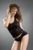 Happy woman listening music and dancing Stock Photography