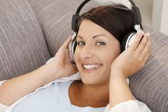 Happy woman listening music on headphones Royalty Free Stock Photos