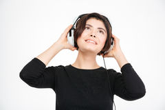 Happy woman listening music in headphones. Isolated on a white background Royalty Free Stock Photography