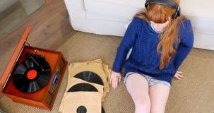 Happy woman listening music on headphones 4k