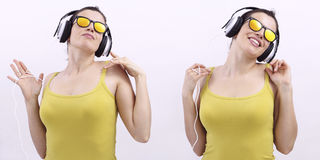 Happy woman listening music on headphones and wearing sunglas Stock Image