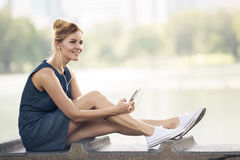 Happy woman listening music on line with headphones Royalty Free Stock Photos