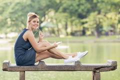 Happy woman listening music on line with headphones Stock Images