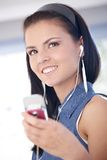 Happy woman listening music through mobile Royalty Free Stock Photo