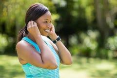 Happy woman listening music Royalty Free Stock Image