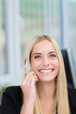 Happy Woman Listening To Her Mobile Phone Royalty Free Stock Photography