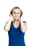 Happy woman listening to music Stock Photos