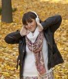 Happy woman listening to music stock photo