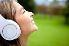 Happy woman listening to music Stock Image