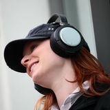 Happy Woman Listening to Music Stock Photo