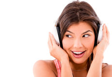 Happy woman listening to music Royalty Free Stock Images