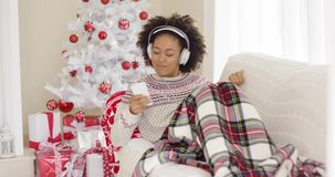 Happy woman listening to music on Christmas Day stock footage