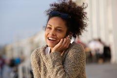 Happy woman listening to music on earphones Stock Photography