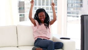 Happy woman listening to music Royalty Free Stock Image