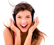 Happy woman listening to music Stock Images