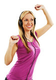 Happy woman listening to music with headphones Royalty Free Stock Photo