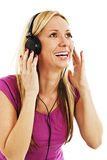 Happy woman listening to music with headphones Royalty Free Stock Photos