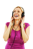 Happy woman listening to music with headphones Royalty Free Stock Photography