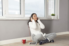 Happy woman listening to music at home Royalty Free Stock Images
