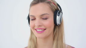 Happy woman listening to music while laughing stock footage