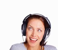 Happy woman listening to music while looking up Royalty Free Stock Photography