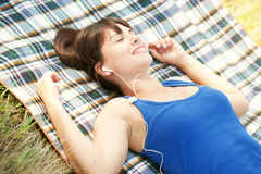 Happy woman listening to music on picnic Royalty Free Stock Photography
