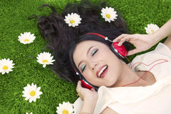 Happy woman listens to music outdoor Royalty Free Stock Photography