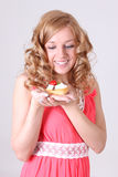 Happy woman with little cake in hand Royalty Free Stock Images