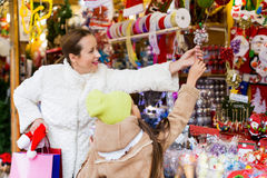 Happy woman with little daughter buying gifts Stock Images