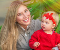 Happy woman with little daughter royalty free stock photo