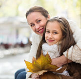 Happy woman with little daughter Royalty Free Stock Image