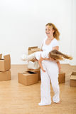 Happy woman and little girl in a new home royalty free stock photo