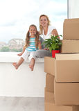 Happy woman and little girl in a new home Stock Images