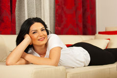 Happy woman in living room Royalty Free Stock Image