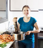 Happy woman with lobster Royalty Free Stock Photo
