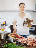 Happy woman with lobster Stock Photos