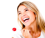 Happy woman with a lollipop Royalty Free Stock Photo